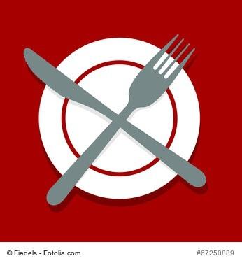 Nie wieder Kohlenhydrate - gekreuztes Besteck auf Teller